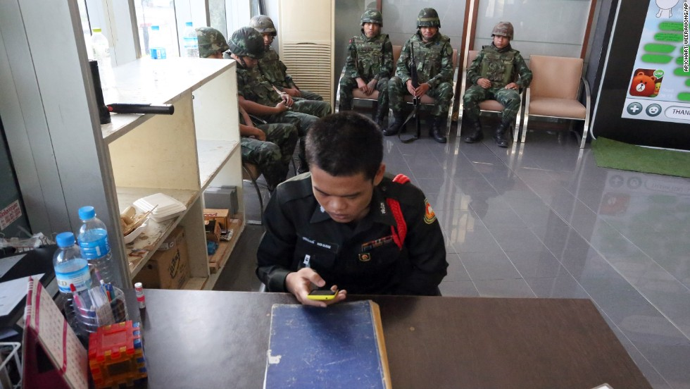 Soldiers sit in the lobby of the National Broadcasting Services of Thailand building on May 20.