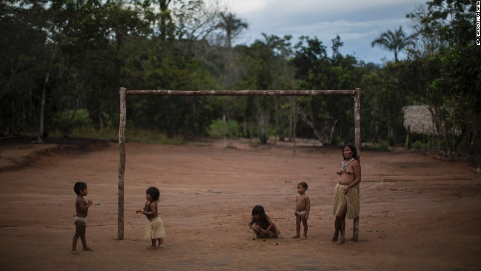 MAY 20 - MANAUS, BRAZIL: Children from several tribes play at a soccer field in the Tatuyo indigenous community near Manaus. The town is one of the host cities for the 2014 World Cup in Brazil which starts in 23 days.