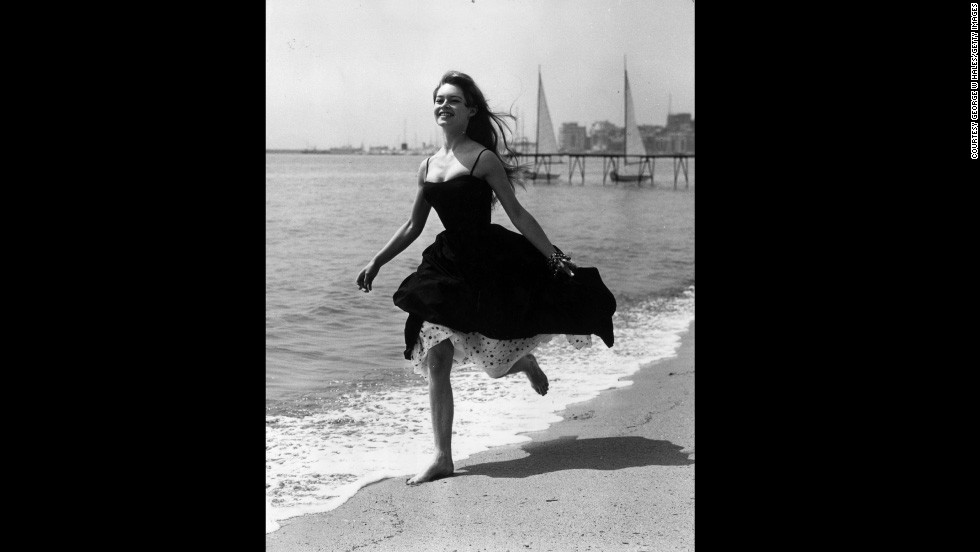 "Film star Brigitte Bardot eschews footwear altogether and runs barefoot on a beach in Cannes during the 1956 festival, where ""The Silent World"" by Jacques-Yves Cousteau and Louis Malle won the Palme d'Or."