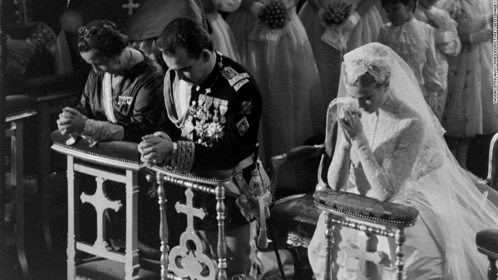 "Grace Kelly and Prince Rainier -- shown here kneeling during Mass at their wedding at St. Nicholas Cathedral in Monaco in 1956 -- had <a href=""http://time.com/3684060/life-with-grace-kelly-and-prince-rainier-photos-from-the-wedding-of-the-century/"" target=""_blank"">a spectacular gathering fit for a king ... uh, prince</a>."