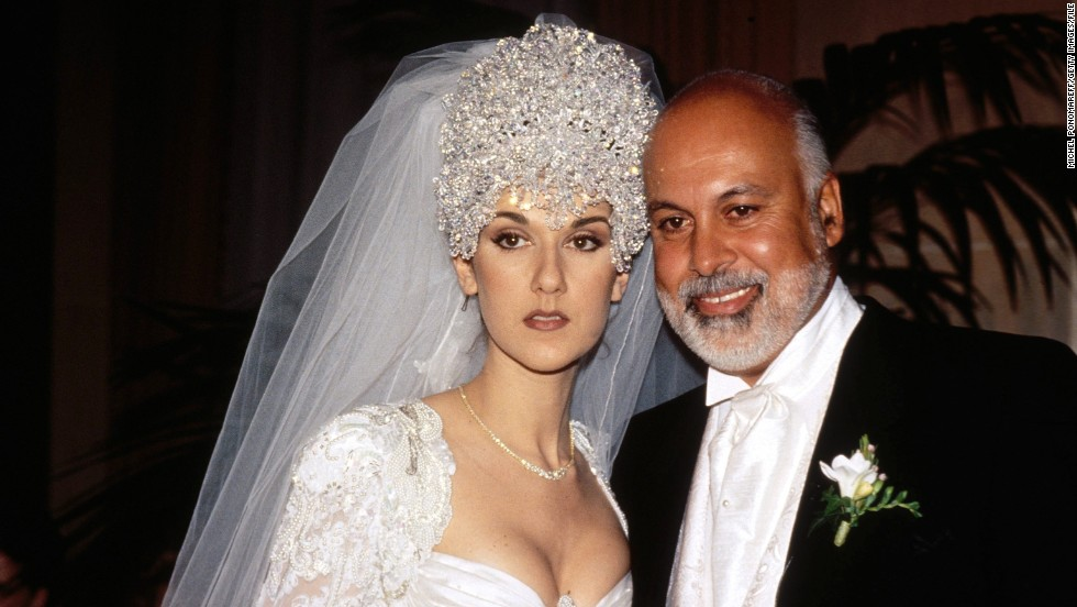 "Celine Dion married manager René Angélil in 1994 in Montreal. Her dress <a href=""http://xfinity.comcast.net/slideshow/music-musicweddings/"" target=""_blank"">reportedly had a 20-foot train, and she wore a 7-pound tiara made up of thousands of Austrian crystals. </a>"