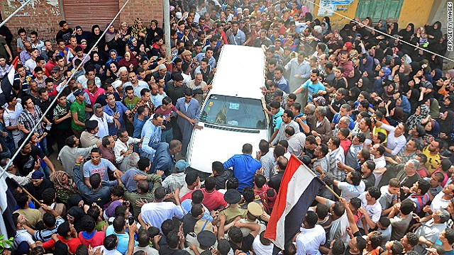 Mourners gather at a funeral after deadly clashes in Cairo.