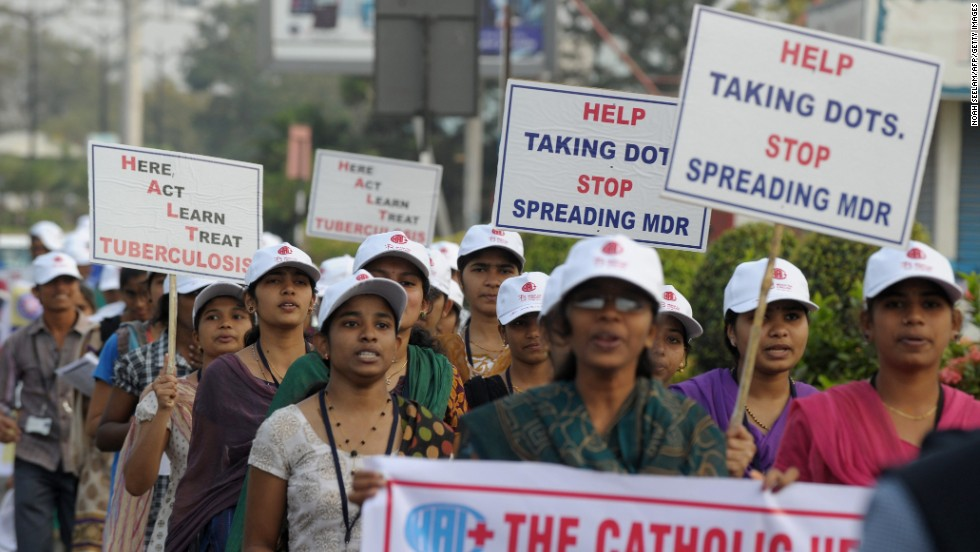 "Pictured, Indian nursing students at an awareness rally in Hyderabad, on March 24, 2014. Their placards are encouraging ""DOTS"" the WHO's TB control strategy that includes effective testing and a reliable drug supply."