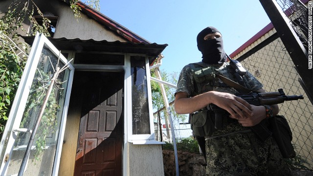 An armed pro-Russian miltant guards on the check-point Semenovka, near eastern Ukrainian city of Slavyansk on May 21, 2014.