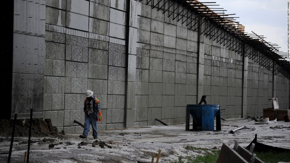 A worker walks through a construction site after the storm in Aurora on May 21.