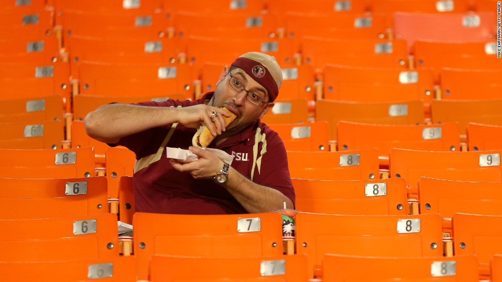 A Florida State Seminoles fan eats a hot dog prior to the 2013 Orange Bowl at Sun Life Stadium in Miami Gardens, Florida.