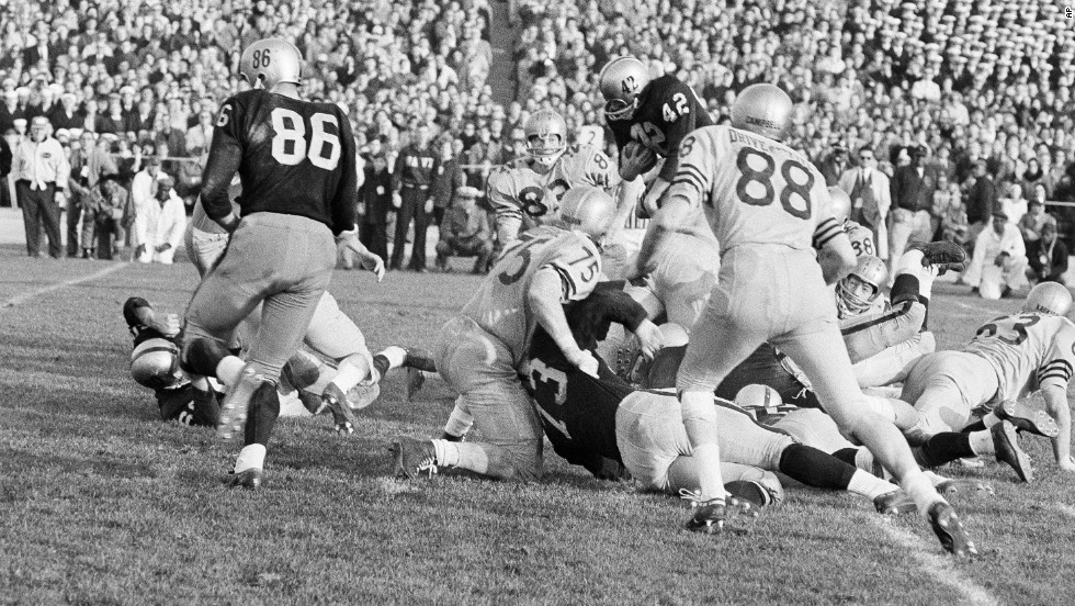 "In 1963's thrilling Army-Navy game, Navy beat Army 21-15 behind Heisman Trophy-winning quarterback Roger Staubach. Today, the game is best remembered for the introduction of instant replay -- though many TV watchers <a href=""http://www.wired.com/2010/12/1207army-navy-game-first-instant-replay/"" target=""_blank"">were unaware of the technology and slammed CBS' switchboard</a> in confusion. Now instant replay is a regular part of sports broadcasts."