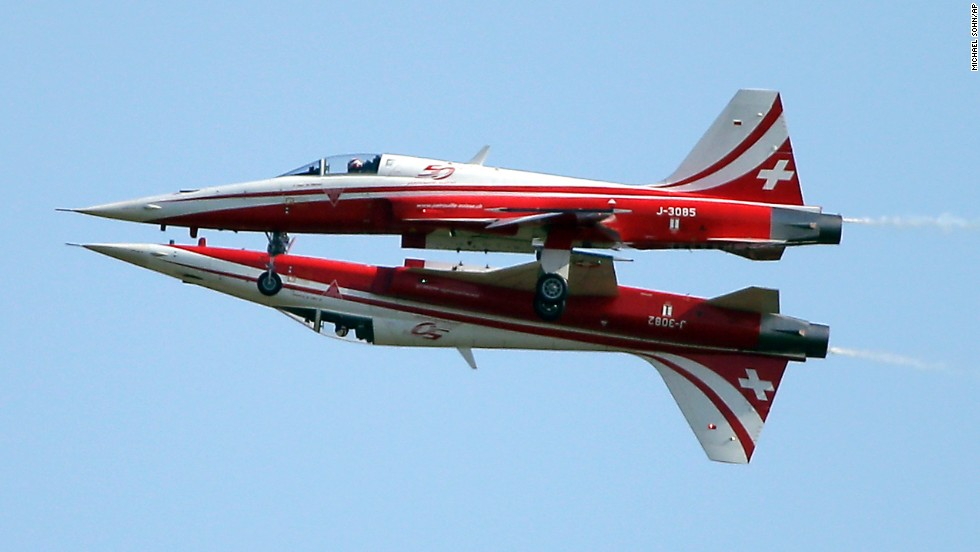 Two jets from the Swiss Patrol, an aerobatic team in the Swiss Air Force, fly close together during the Berlin Air Show on Tuesday, May 20. The air show continues through Sunday, May 25.