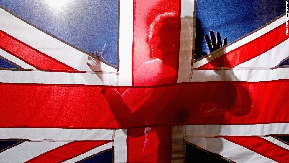"A staff member at James Stevenson Flags holds a Union Flag on Tuesday, May 20, in Glasgow, Scotland. A referendum on whether Scotland <a href=""http://www.cnn.com/2014/03/18/world/europe/scotland-independence-referendum-explainer/index.html"">should be an independent country</a> will take place in September."