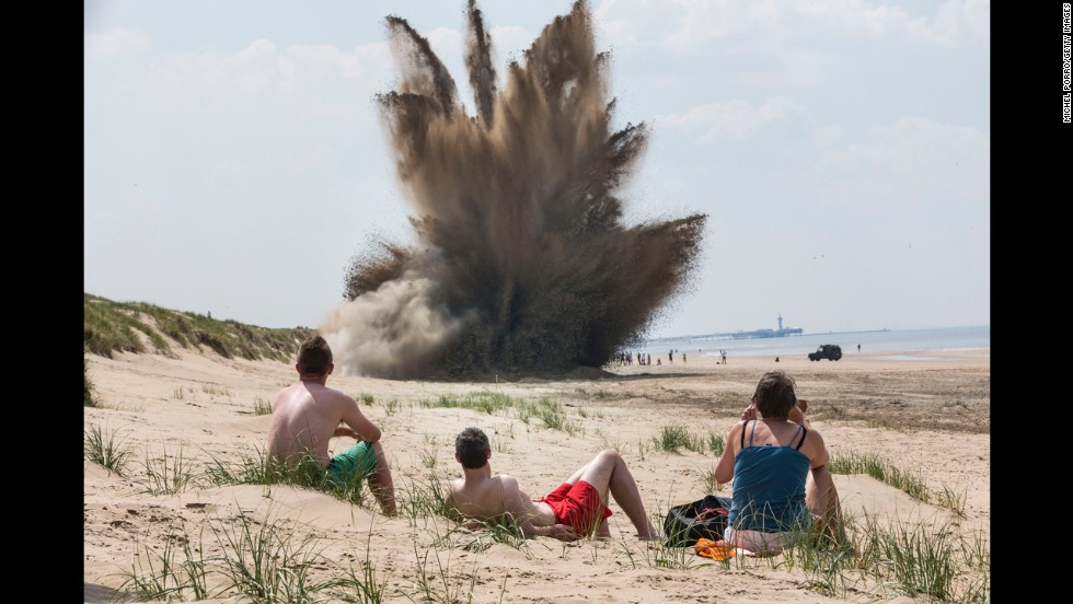 Beachgoers in Wassenaar, Netherlands, watch the detonation of a 500-pound British bomb on Monday, May 19. The World War II-era bomb was found earlier this month at a building site in nearby Leiden.