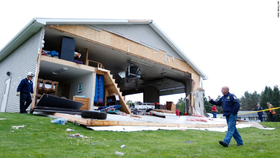 Officials inspect damage to the Duanesburg Volunteer Ambulance Corps on May 22 in Duanesburg, New York, after a severe storm passed through the area.