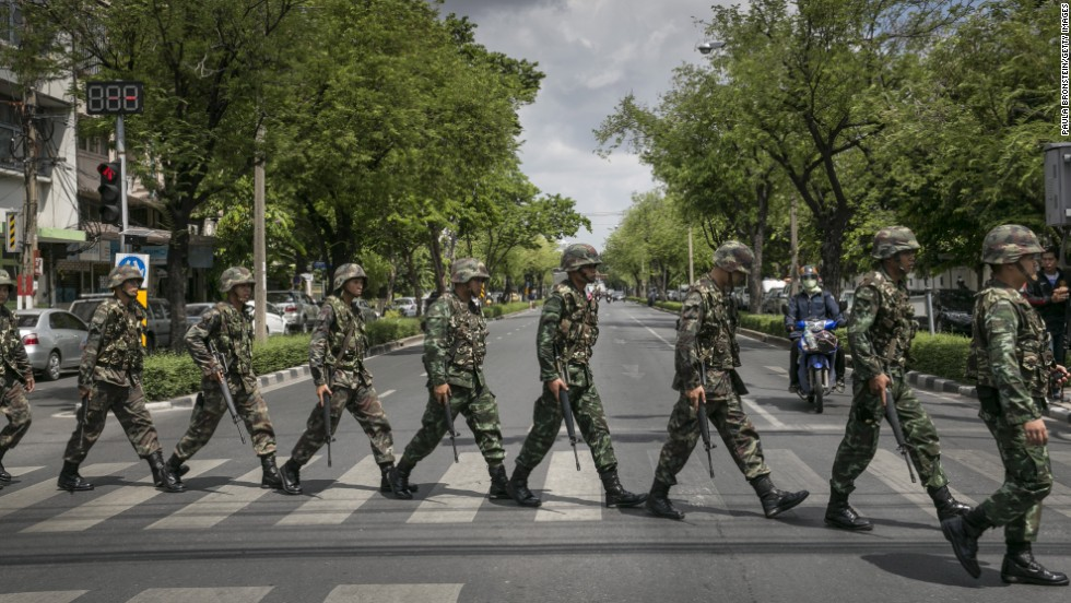 """Thai soldiers patrol near government buildings in Bangkok on Friday, May 23. Thailand's army announced the previous day that it has taken control of the country in a coup, just days after it surprised the government by declaring martial law.  <a href=""""http://www.cnn.com/2014/05/19/asia/gallery/thailand-crisis/index.html"""" target=""""_blank"""">See the Thai army impose martial law before the coup.</a>"""