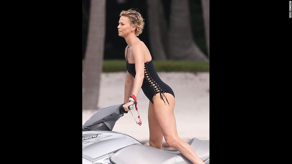 Charlize Theron goes for a ride on a Jet Ski while in Miami, Florida, in March 2014.