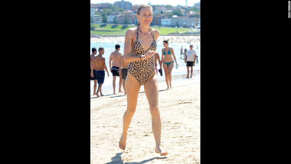 Naomi Watts sprints across Bondi Beach in Sydney, Australia, in December 2013.