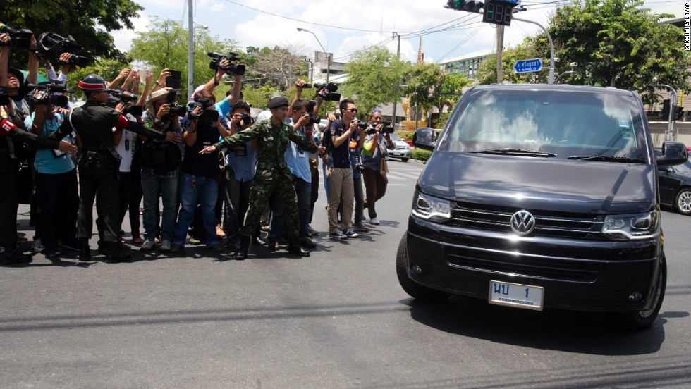 Former Prime Minister Yingluck Shinawatra arrives to report to Thailand's ruling military in Bangkok on May 23.