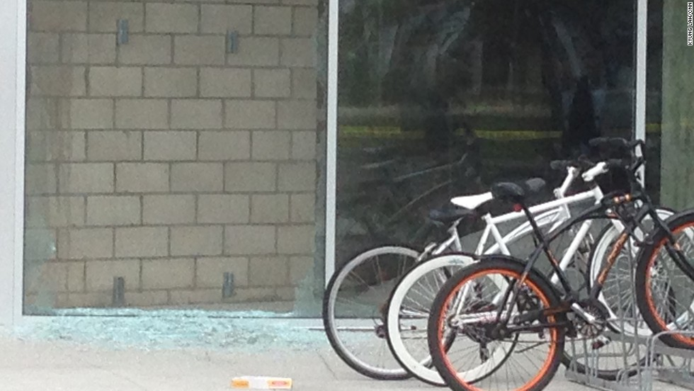 Broken glass at the shooting scene Saturday.  Authorities said there were multiple crime scenes.