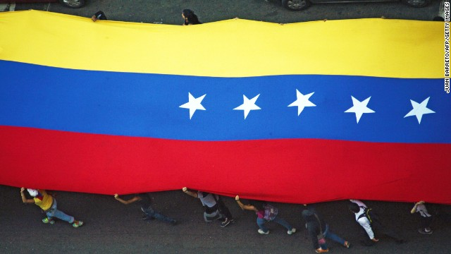 VENEZUELA-OPPOSITION-PROTEST : News Photo View similar imagesMore from this photographerDownload compEmbedShare VENEZUELA-OPPOSITION-PROTEST Caption:Opposition activists walk with a national flag with during a protest against the government of Venezuelan President Nicolas Maduro in Caracas on May 16, 2014. AFP PHOTO /JUAN BARRETO (Photo credit should read JUAN BARRETO/AFP/Getty Images)