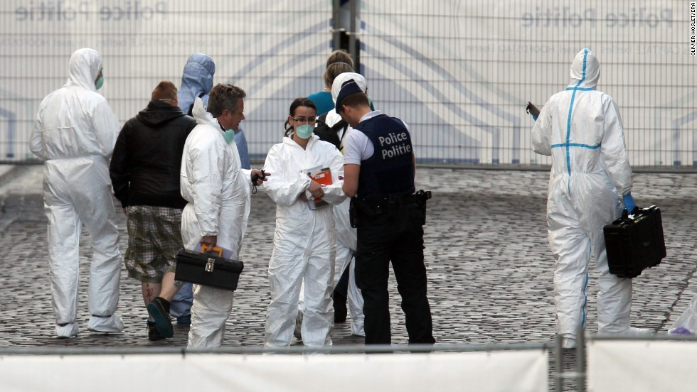 Police and crime scene investigators work at the scene of the shootings on May 24. A person arrived by car at the museum, entered and quickly opened fire before leaving, Belgian Interior Minister Joelle Milquet told CNN affiliate Bel RTL.