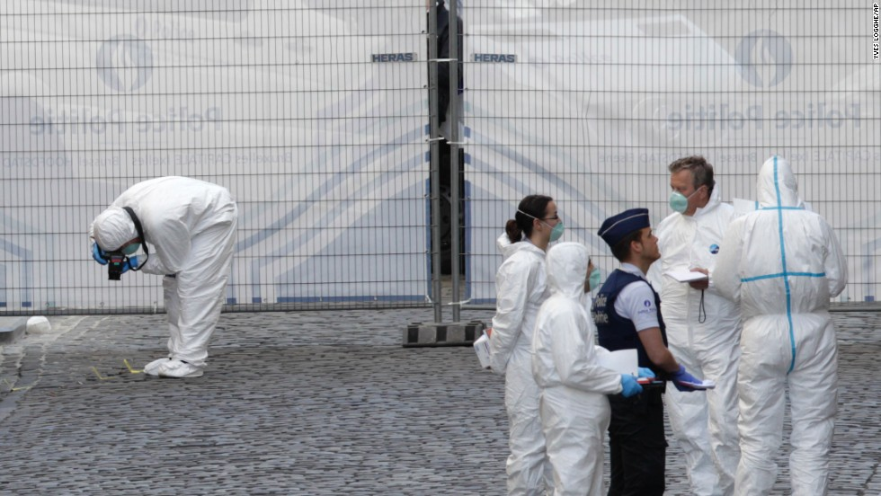 Forensic experts examine the shooting site on May 24.