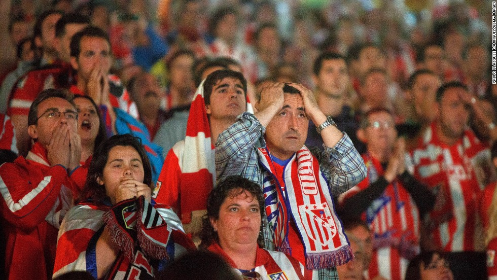 Atletico fans react during the match.