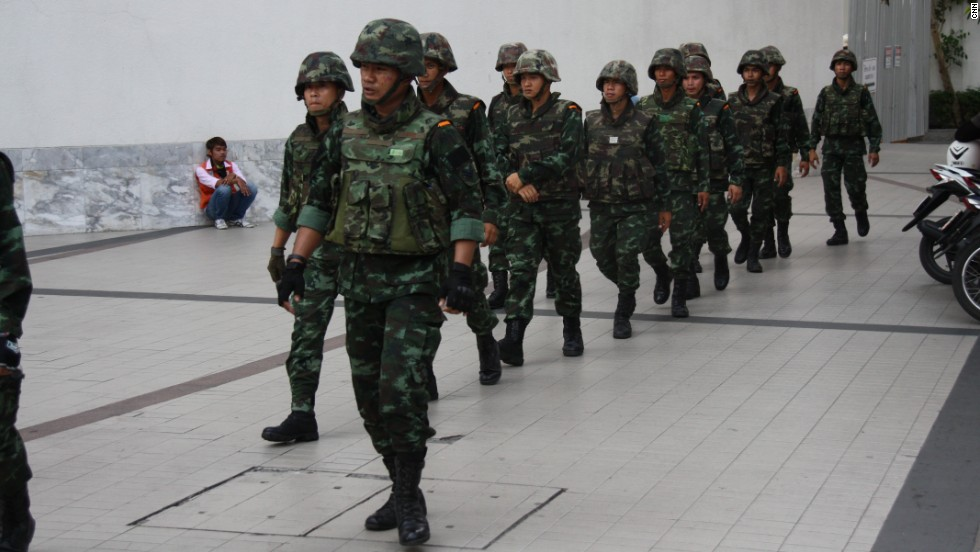 Troops on the ground in central Bangkok on March 24 monitor protests against the Thai military's coup.