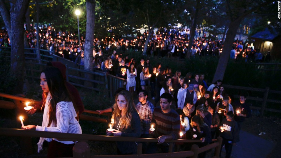 People gather at a park in Isla Vista for the May 24 vigil.