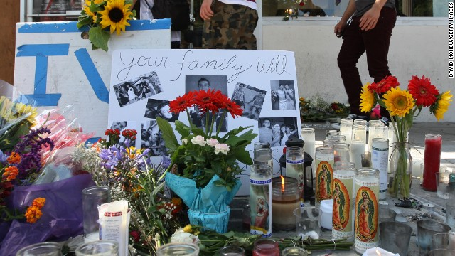A makeshift memorial is front of the I.V. Deli in Isla Vista, California, where Christopher Michaels-Martinez, 20, was murdered.