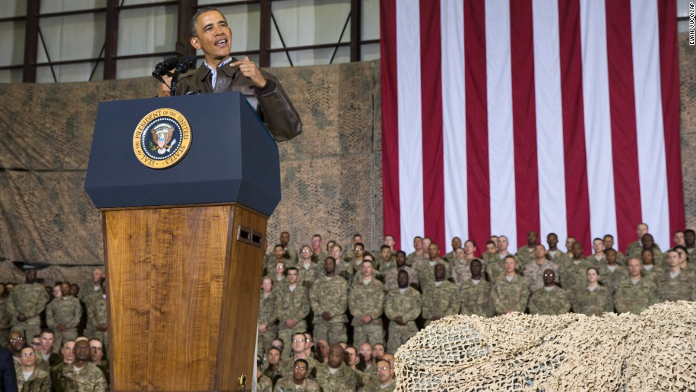 Obama speaks during a troop rally after arriving at Bagram Air Field.