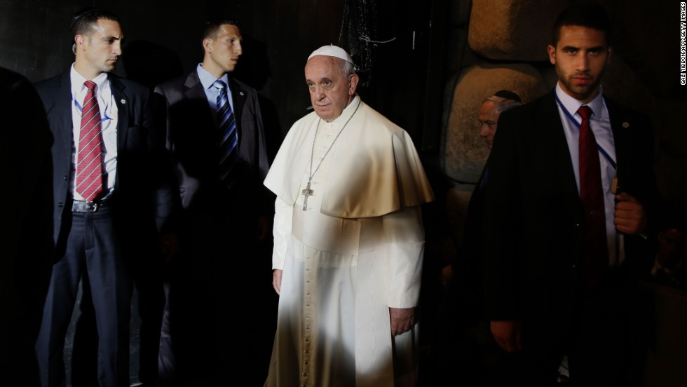 Surrounded by Israeli security guards, Francis leaves the Hall of Remembrance at the Yad Vashem Holocaust Memorial and Museum in Jerusalem on May 26.