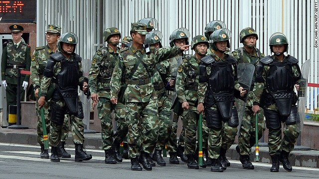 Fully armed Chinese paramilitary police patrol a street in Urumqi, Xinjiang.