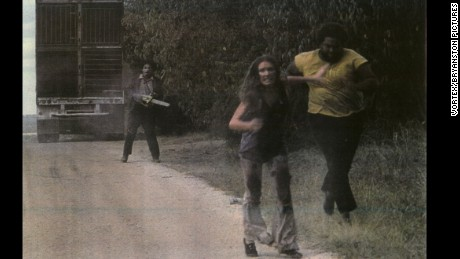 "Hansen, left, as Leatherface in 1974's ""The Texas Chainsaw Massacre."""