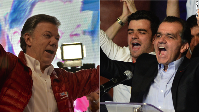 In the preliminary tally, incumbent President Juan Manuel Santos (left) had secured 25.6% of votes, coming in behind Oscar Ivan Zuluaga (right) with 29.3% of votes.
