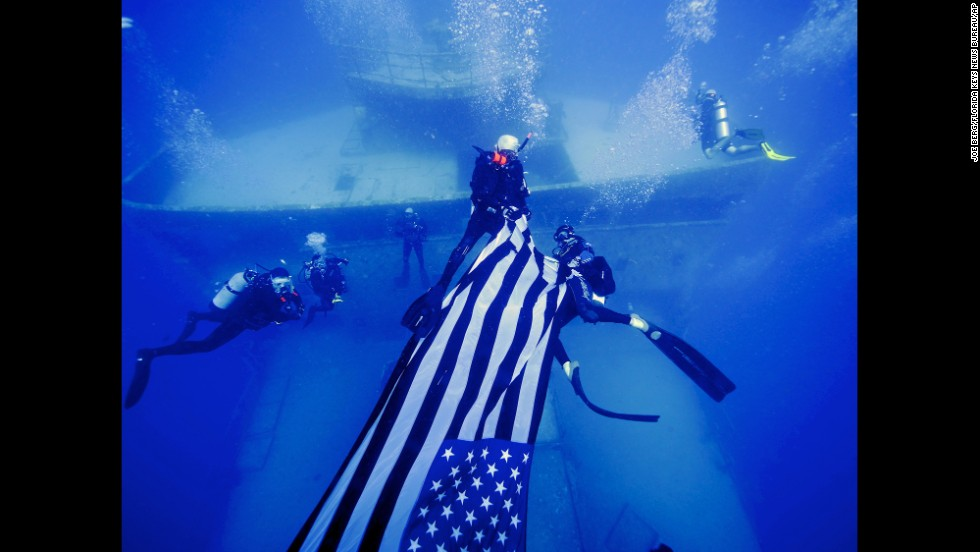 "For <a href=""http://www.cnn.com/2014/05/26/us/gallery/memorial-day-2014/index.html"">Memorial Day</a>, divers deploy an American flag on the USNS General Hoyt S. Vandenberg, an artificial reef about seven miles off Key West, Florida, on Sunday, May 25."