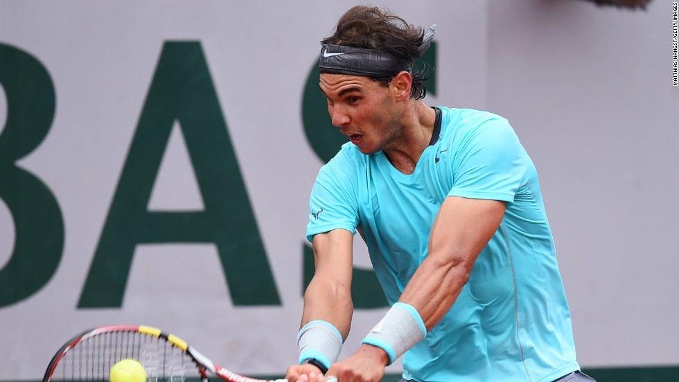 Rafael Nadal bludgeons another return during his straight sets win over Robby Ginepri in Paris.