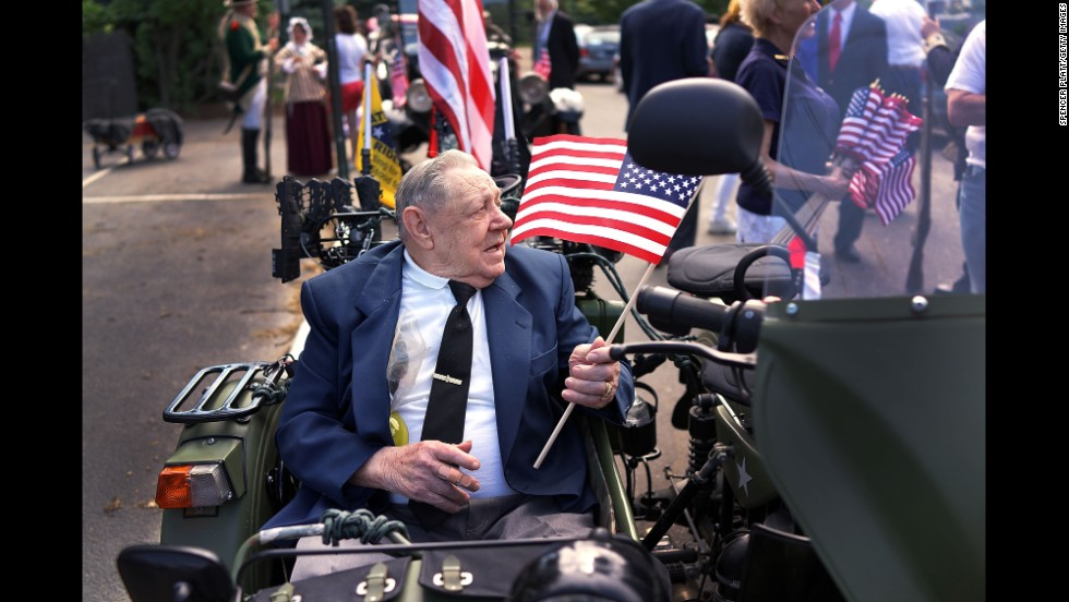 Joseph Felner, who was part of the D-Day landing operation during World War II, participates in the Memorial Day parade in Fairfield on May 26, 2014.
