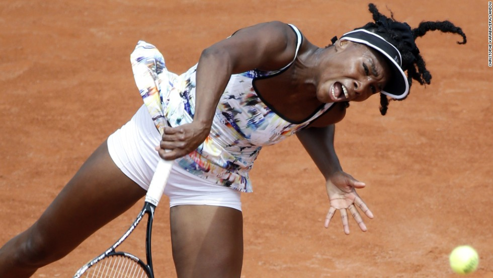Venus Williams serves to Belinda Bencic in the first round of the French Open on Sunday, May 25. Williams won the match 6-4, 6-1.
