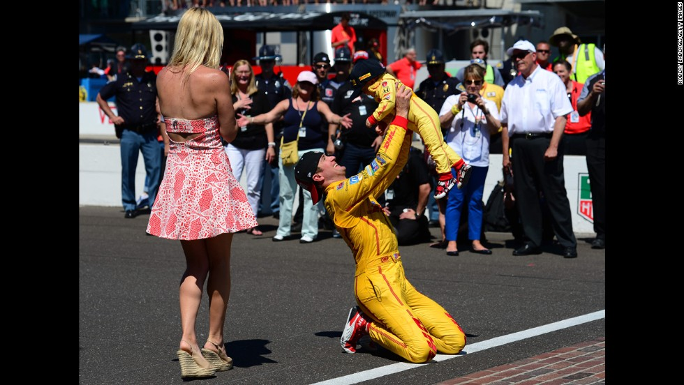 Ryan Hunter-Reay holds up his son, Ryden, at the finish line after winning the Indianapolis 500 on Sunday, May 25. His wife, Beccy, is at left. Hunter-Reay held off Helio Castroneves to win the race by .06 seconds, the second-closest finish in Indianapolis 500 history.