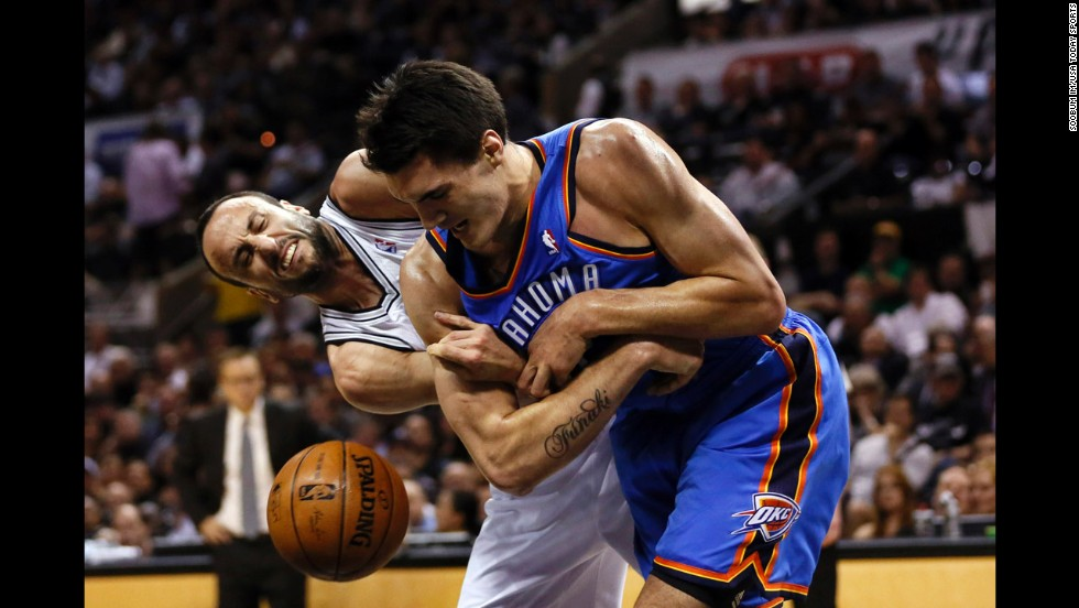 Oklahoma City Thunder center Steven Adams, right, and San Antonio Spurs guard Manu Ginobili battle for the ball in Game 2 of the NBA's Western Conference finals Wednesday, May 21, in San Antonio. The Spurs won 112-77 to take a 2-0 lead in the best-of-seven series.