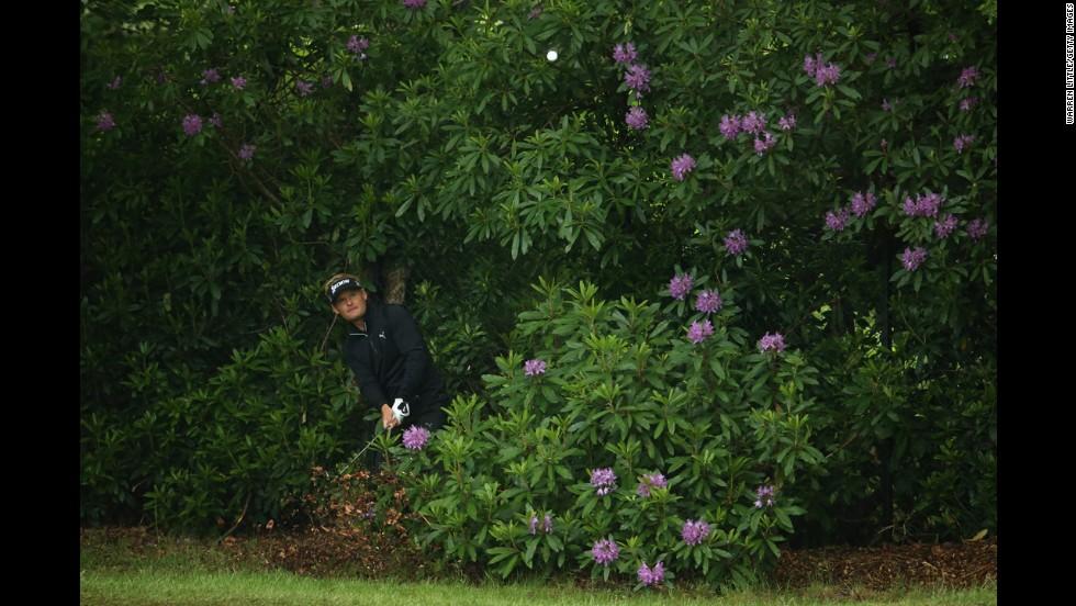 Golfer Soren Kjeldsen hits from a bush during the BMW PGA Championship on Thursday, May 22.
