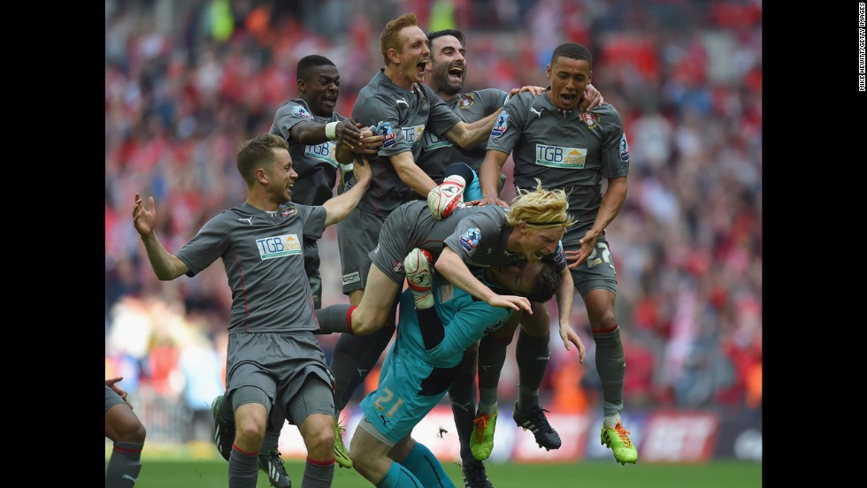 Rotherham goalkeeper Adam Collin is mobbed by his teammates after a penalty shootout victory over Leyton Orient on Sunday, May 25, in London. It was the playoff final of League One, the third division of English soccer, and Rotherham's win clinched the team's promotion into the second division.