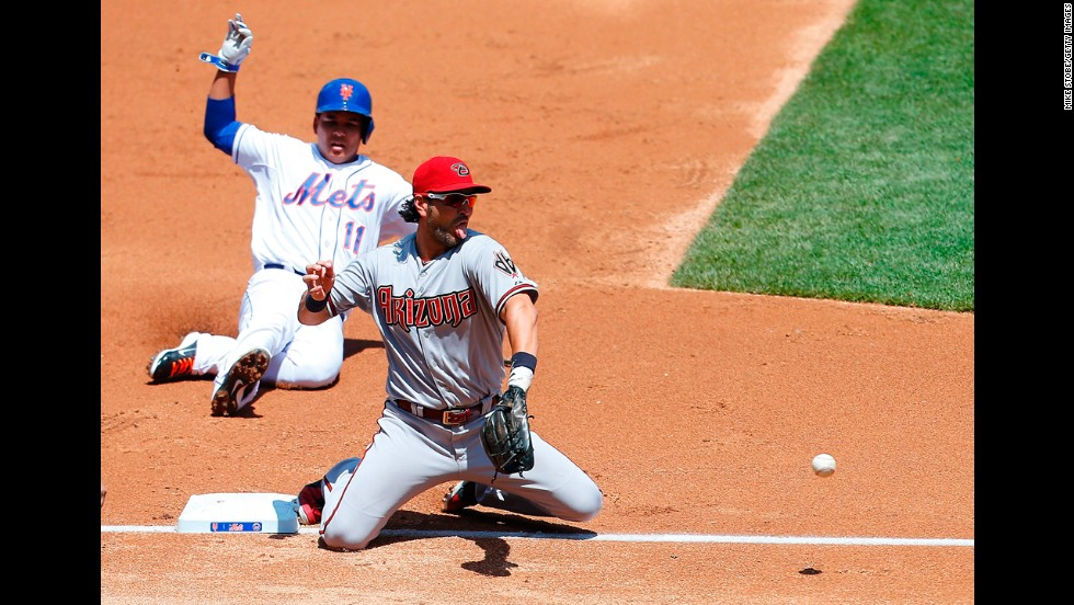Ruben Tejada of the New York Mets slides into third base, but he is forced out by Eric Chavez of the Arizona Diamondbacks on Sunday, May 25. The two teams split a doubleheader Sunday at New York's Citi Field.
