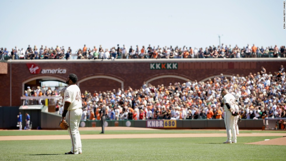 Pablo Sandoval, left, and David Huff of the San Francisco Giants stand for a moment of silence during their Memorial Day game against the Chicago Cubs at AT&T Park in San Francisco on May 26, 2014.