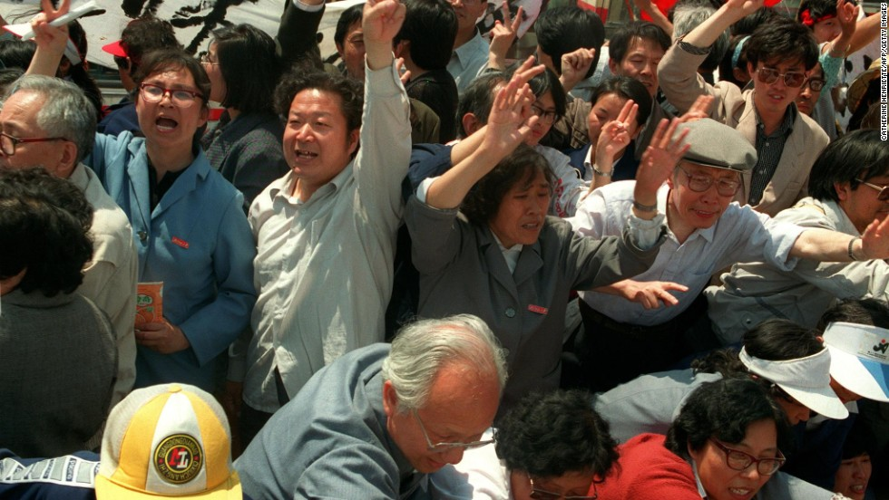 May 20, 1989, teachers from Beijing Normal University arrive at Tiananmen Square by the truckload to support their students after martial law was declared.
