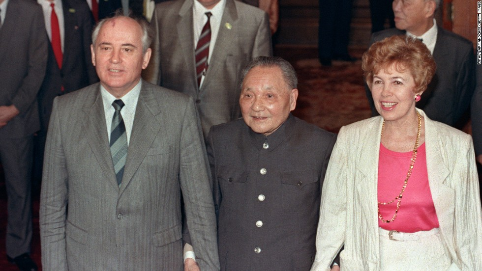 May 16, 1989, then Chinese President Deng Xiaoping (center) takes then Soviet President Mikhail Gorbachev and his wife Raisa by the hand at the Great Hall of the People. Gorbachev's visit coincided with the student hunger strikes, forcing the official reception to be moved from Tiananmen Square to the airport -- embarrassing for the Chinese leadership.
