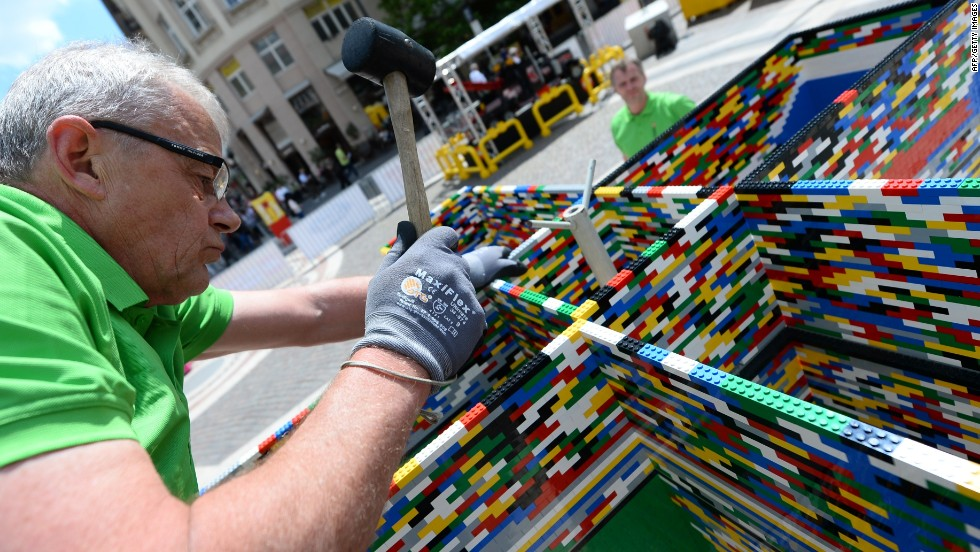 "Guinness World Records said the tower is officially the ""tallest structure built with interlocking plastic bricks."""