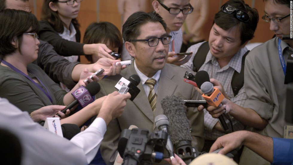 Members of the media scramble to speak with Azharuddin Abdul Rahman, director general of Malaysia's Civil Aviation Department, at a hotel in Kuala Lumpur, Malaysia, on May 27. Data from communications between satellites and missing Malaysia Airlines Flight 370 was released the day before, more than two months after relatives of passengers say they requested that it be made public.