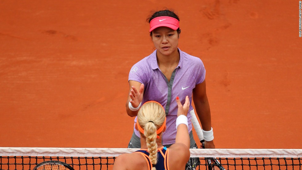 China's Li Na, French Open champion in 2011, congratulates opponent Kristina Mladenovic after being defeated by the Frenchwoman in the opening round at Roland Garros.