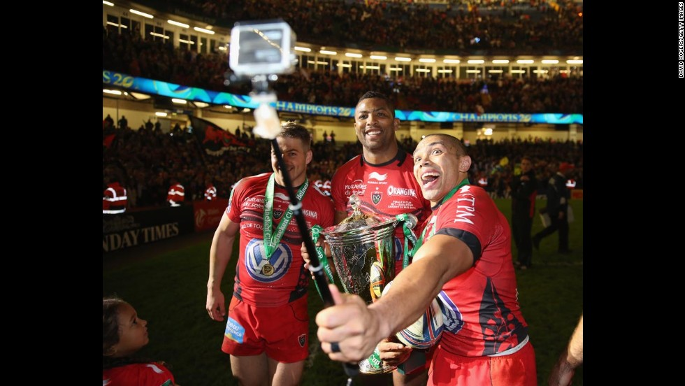 Bryan Habana of the French rugby club Toulon takes a selfie with teammates Deion Armitage, center, and Drew Mitchell after they defeated English club Saracens to win the Heineken Cup, Europe's top rugby competition, on Saturday, May 24, in Cardiff, Wales.