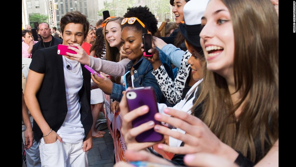 "Singer Austin Mahone meets with fans before performing on NBC's ""Today"" show Monday, May 26, in New York."