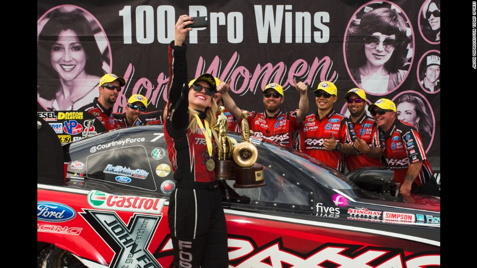 NHRA funny-car driver Courtney Force celebrates after winning the Kansas Nationals on Sunday, May 25, in Topeka, Kansas.